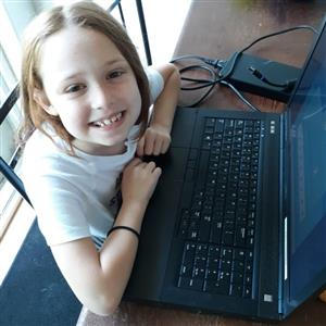 Young girl in front of computer