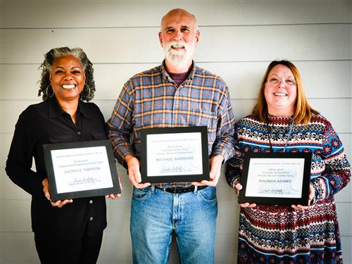 Patrice Timpson, Michael Barbero, Rhonda Adams display certificates